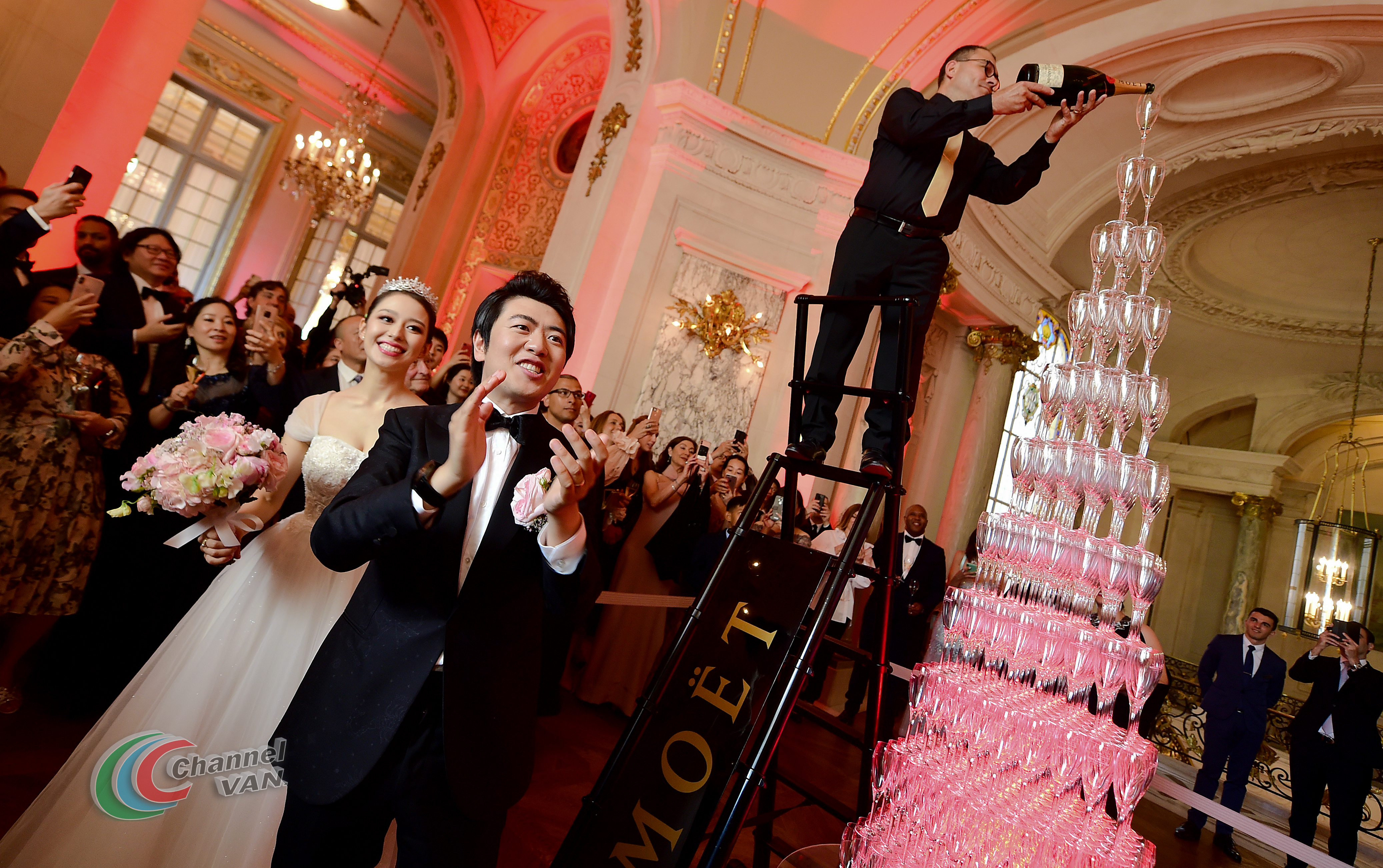 PARIS, FRANCE - JUNE 02: Pianists Lang Lang & Gina Alice celebrate their wedding in front of a Moet et Chandon Champagne pyramid during their Cocktail Wedding at Hotel Shangri-La on June 02, 2019 in Paris, France. (Photo by Anthony Ghnassia/Getty Images for Moet Henessy)