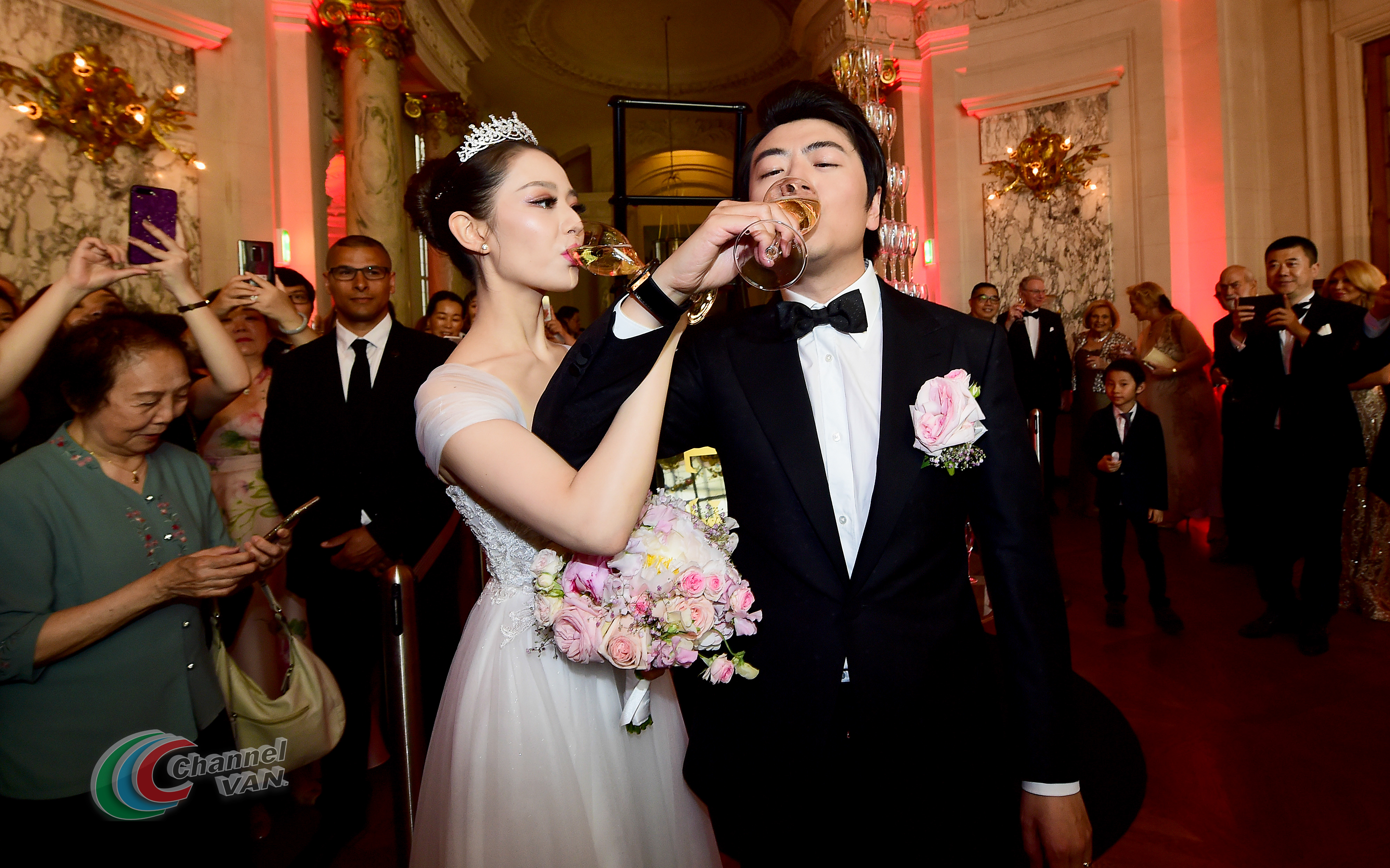 PARIS, FRANCE - JUNE 02: Pianists Lang Lang & Gina Alice drink a glass of Moet et Chandon Champagne during their Cocktail Wedding at Hotel Shangri-La on June 02, 2019 in Paris, France. (Photo by Anthony Ghnassia/Getty Images for Moet Henessy)
