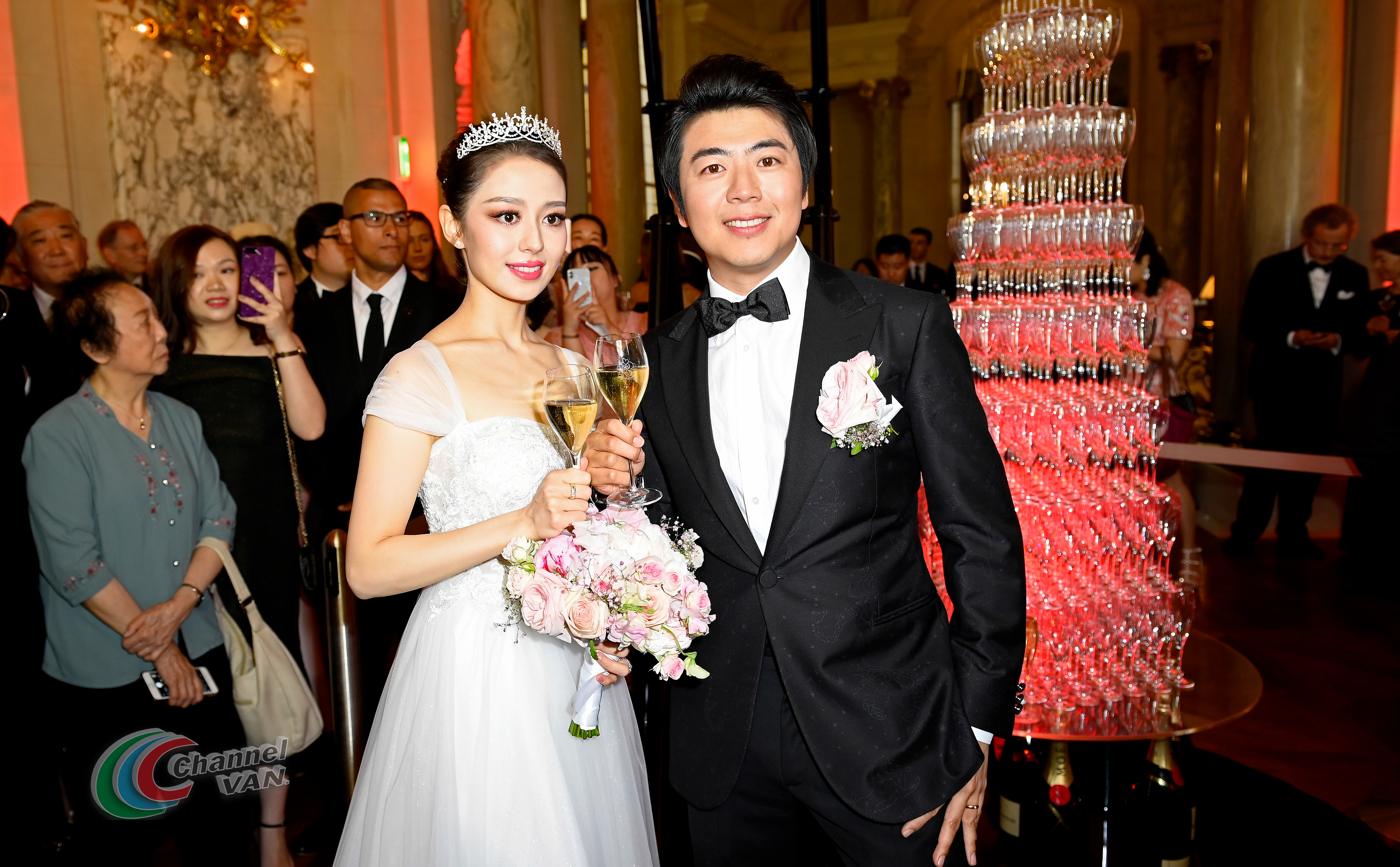 PARIS, FRANCE - JUNE 02: Pianists Lang Lang & Gina Alice drink a glass of Moet et Chandon Champagne during their Cocktail Wedding at Hotel Shangri-La on June 02, 2019 in Paris, France. (Photo by Kristy Sparow/Getty Images for Moet Hennessy)